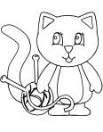chat qui joue avec une pelotte de laine