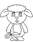 petit agneau avec une paire de ciseaux